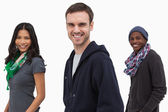 Happy stylish young in a line — Stock Photo