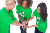 Three enviromental activists putting their hands together — Stock Photo