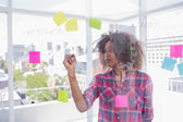 Woman with afro drawing on flowchart with marker — Stock Photo