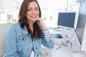 Attractive designer smiling in creative office — Stock Photo
