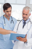 Two doctors talking about a file — Stock Photo