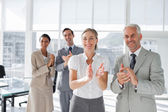 Group of business applauding together — Stok fotoğraf