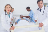 Serious doctors ready to move — Stock Photo