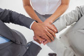 United team piling up their hands — Stock Photo