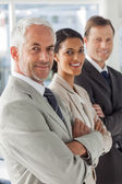 Cheerful business looking in the same way — Stock Photo