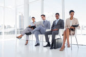 Well dressed business sat together — Stock Photo