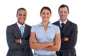 Small group of smiling business standing together — Stock Photo