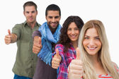 Friends giving thumbs up in a row — Stock Photo