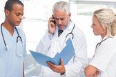 Three worried doctors — Stock Photo