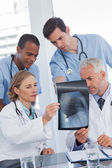Serious medical team examining radiography — Stock Photo