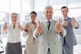 Business giving thumbs up — Stock Photo