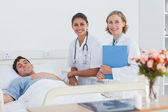 Two doctors and a patient looking at the camera — Stock Photo