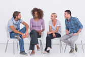 Stylish sitting and chatting — Stock Photo