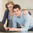 Happy couple on laptop — Stock Photo