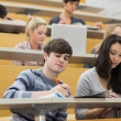 Students listening and taking notes in a lecture — Stock Photo