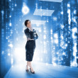 Businesswoman standing and looking thoughtful in data center — Stock Photo