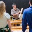Stock Photo: Explaining teacher and woodwork class