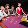 Sitting at the blackjack table smiling at the casino — Foto Stock