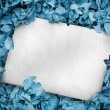 Stock Photo: White poster buried into blue leaves