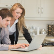 Couple looking at the laptop — Stock Photo #25731221