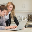 Couple looking at the laptop — Stock Photo