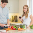 Man cooking with woman drinking red wine — Stock Photo