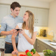 Couple cooking and clinking wine glasses — Stock Photo #25731429