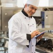 Smiling chef using digital tablet — Stock Photo #25731837