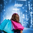 Girl with shopping bags looking at falling matrix — Foto Stock