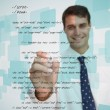 Stock Photo: Smiling businessmwriting sql language