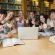 Group of students giving thumbs up — Stock Photo