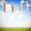 Clothespin on a laundry line outside with bright blue sky — Stock Photo