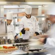 Busy chefs at work in the kitchen — Stock Photo