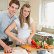 Happy couple cooking together — Stock Photo