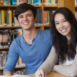 Stock Photo: Two students in library