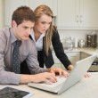 Couple watching something on the laptop — Stock Photo