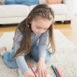 Stock Photo: Little girl sitting at floor