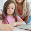 Stock Photo: Mummy and her daughter coloring