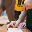 Drilling a hole in a wooden board — Stock Photo