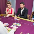 Man and two women playing poker — Stock Photo