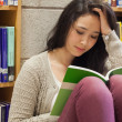 Stressed student reading a book — Foto Stock
