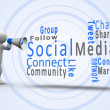 White figure revealing social media terms with a megaphone - Stok fotoğraf