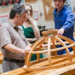 Woodwork class talking about a structure — Stock Photo