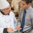 Chef and waiter having a discussion — Stock Photo