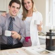 Couple drinking coffee together while reading newspaper — Stock Photo