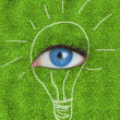 Stock Photo: Blue eye surrounded by drawing of light bulb