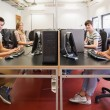 Happy students in computer room — Stock Photo #25733887