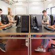 Happy students in computer room — Stock Photo