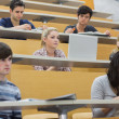 Stock Photo: Class listening in a lecture hall