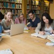 Students learning in a library — Stock Photo
